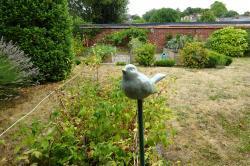 petit oiseau, embout tuteur ou cache-tuteur en grès